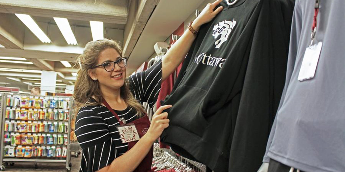 Woman working in the Campus Store