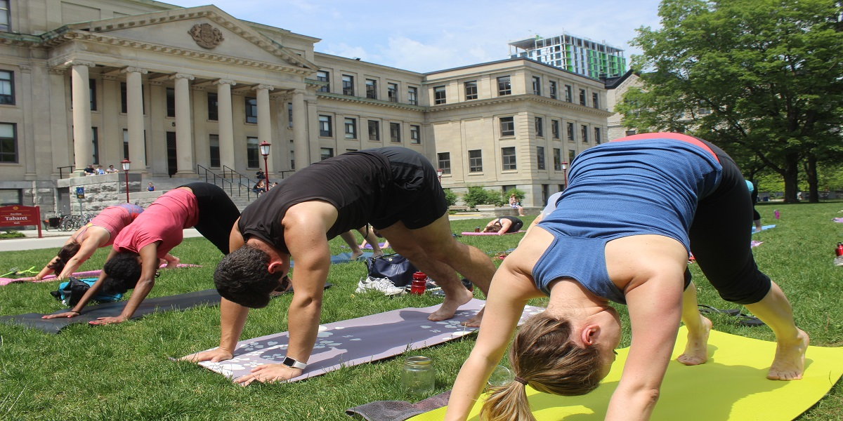 people doing yoga on tabaret lawn