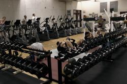 Weights and people training at the Montpetit Fitness Centre.