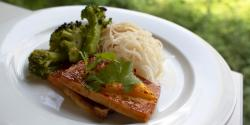 plate with broccoli, rice noodles and tofu