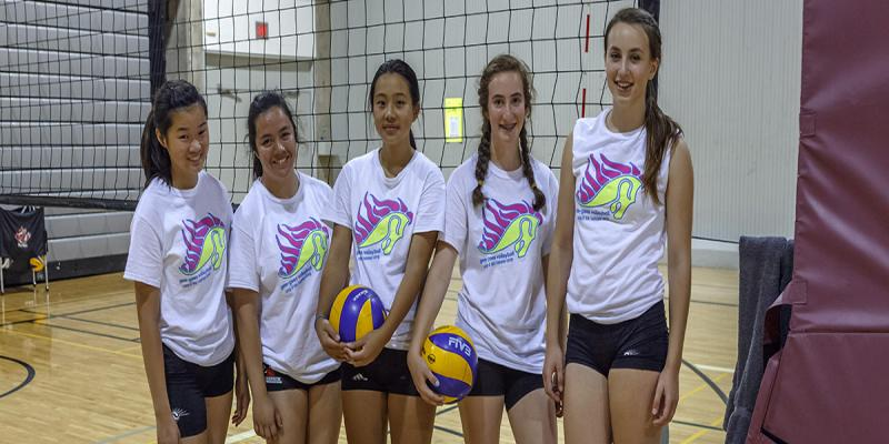Photo of four girls at the volleyball camp.