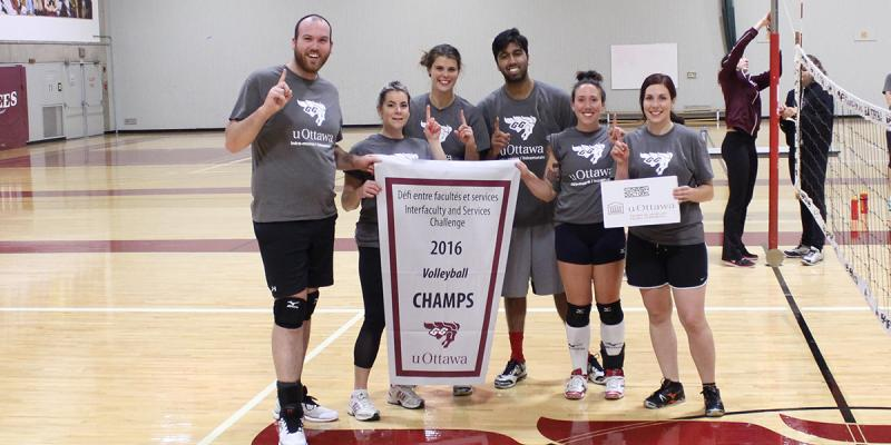 Grey team with IFSC champion banner.