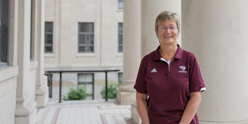Sue Hylland in front of Tabaret Hall.